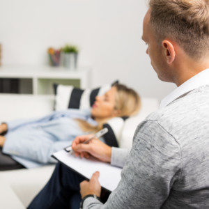 woman receiving hypnosis therapy