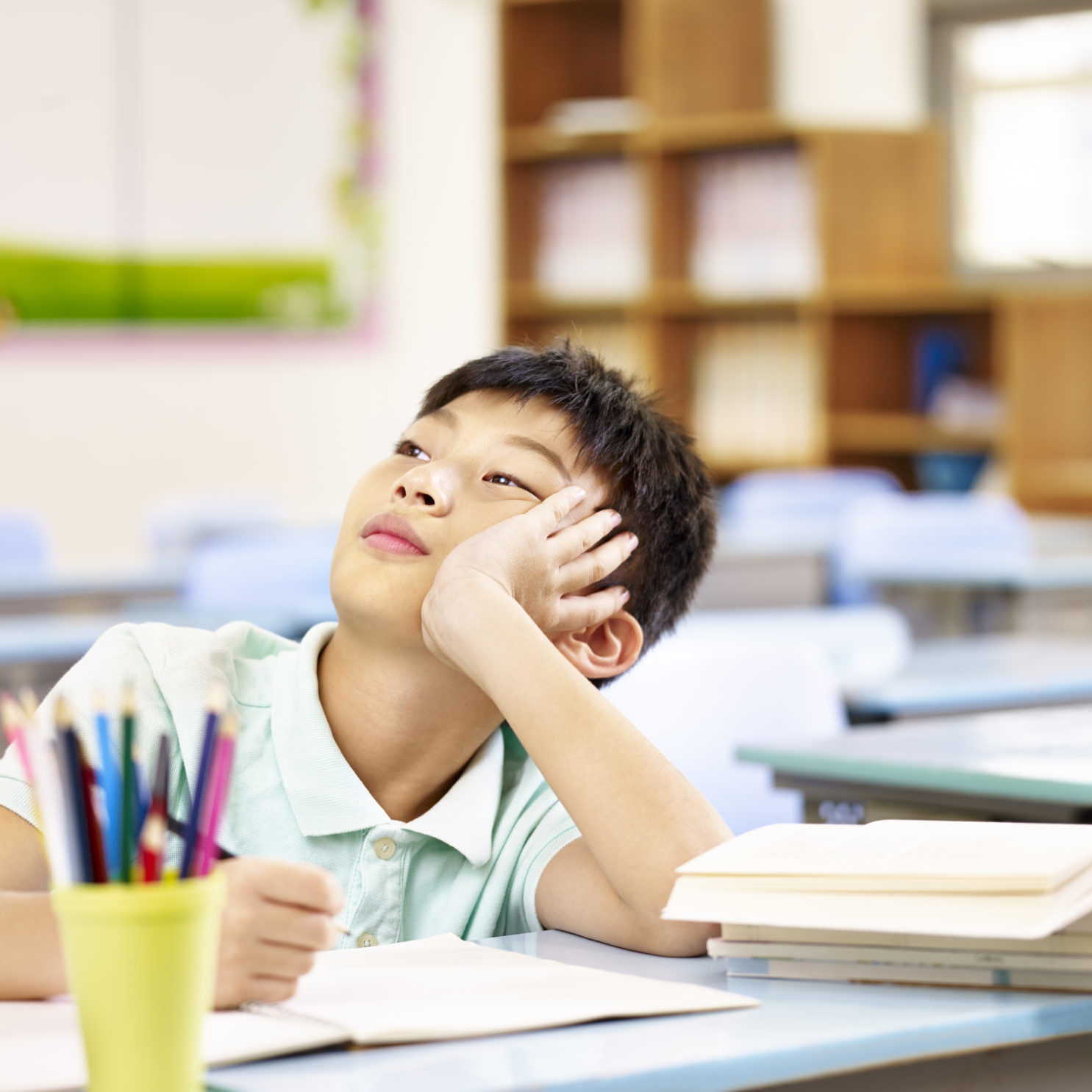 young student not focusing in class due to attention deficit hyperactivity disorder