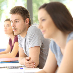 young man focusing with confidence in class after anxiety therapy